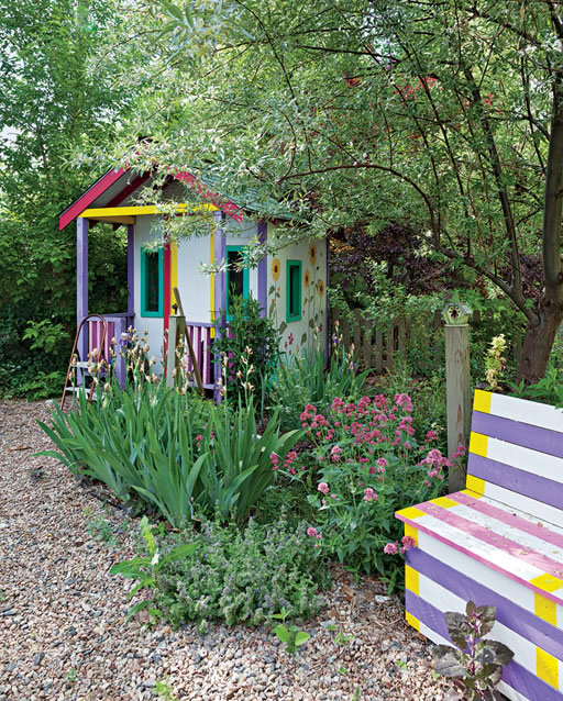 The slightly zany paint job on the garden house and bench