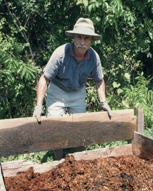 Boards can be added or removed for compost pile.